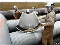 Workers testing pipelines at the Prudhoe Bay oilfield