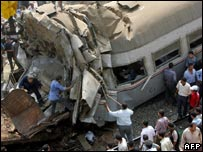 People try to find survivors in the wreckage of the train collision in Qalyoub, Egypt