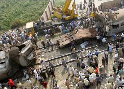 Hundreds of people converge on the scene of the Qalyoub train collision