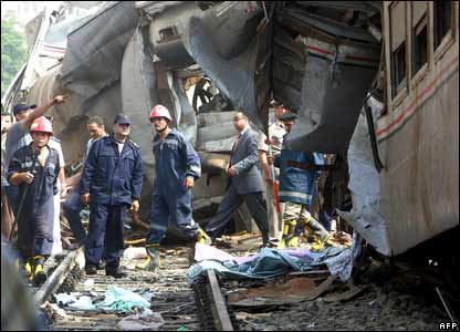 Rescuers at the scene of the train collision in Qalyoub
