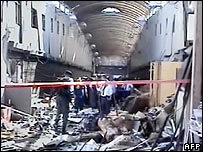 Police investigators at scene of market blast (Russian TV grab), 21 Aug 06
