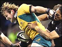 Australia's Rocky Elsom brushes off an All Black tackler in Auckland