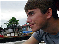 Simon Reeve on a river boat in Borneo