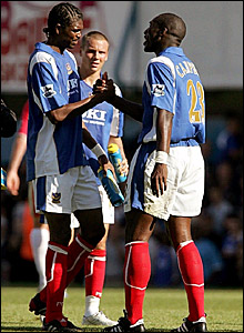 Nwankwo Kanu (left) celebrates scoring in Portsmouth's 3-0 win over Blackburn