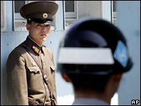 A North Korean soldier looks at a South soldier at the border village of Panmunjom