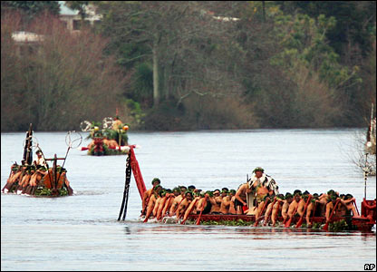 Maori Warriors escort the coffin of Queen Te Arikinui Dame Te Atairangikaahu down the Waikato river during her burial ceremony, 21 August