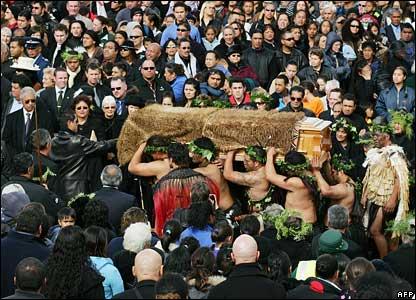 People watch as Maori Warriors carry the coffin of Queen Te Arikinui Dame Te Atairangikaahu from the Waikato River to Mount Taupiri, 21 August