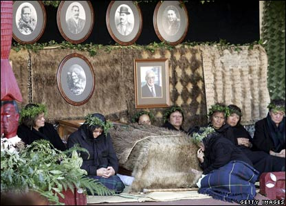 Mourners sit beside the body of the late Maori Queen, Dame Te Atairangikaahu, on 16 August