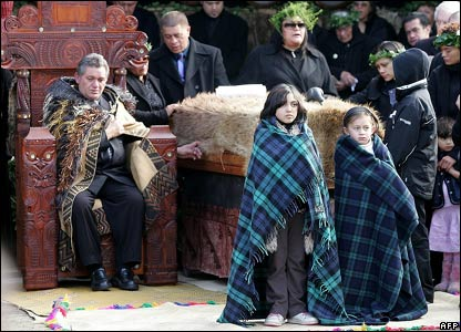 New Maori King Tuheitia Paki sits on his throne next to the coffin of his mother, 21 August