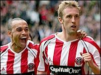 Danny Webber (left) celebrates with Sheffield United goalscorer Rob Hulse