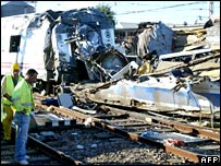 Workers survey wreck of derailed train in Villada, northern Spain. 21 Aug, 2006