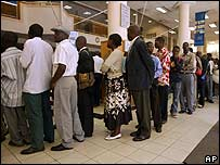 Residents queue at a bank in Harare on Monday to exchange old banknotes for new