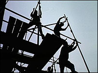 Building workers on scaffolding