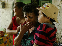 Noemi Becerra, centre, mother of Lucio Rendon wipes a tear after hearing the news about her son on 17 August 2006