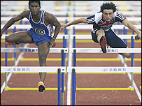 Gianni Frankis competes in the hurdles for GB