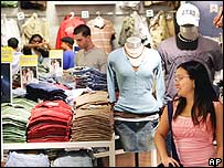 Woman looking at shirts in a shop