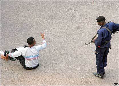 Guard of Joseph Kabila arrests a man outside the presidential palace in central Kinshasa