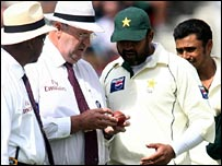Hair inspects the ball with Inzamam-ul-Haq