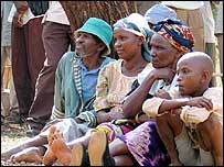 Kenyans listening to President Kibaki's speech