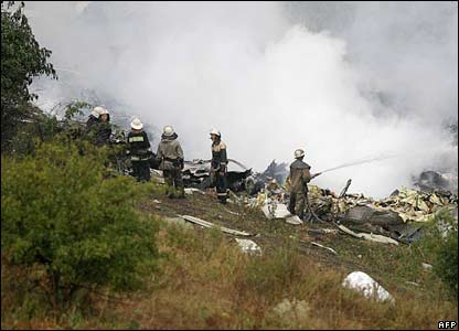 Workers at the plane crash site, eastern Ukraine, 22 August