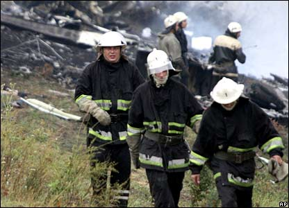 Firemen work at the site of the crash, eastern Ukraine, 22 August