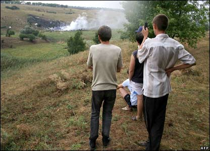 Local residents take pictures of the crash site, eastern Ukraine, 22 August