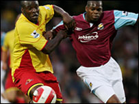 Watford's Danny Shittu (l) and Marlon Harewood tussle for possession