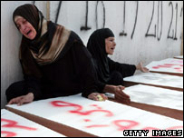 Women grieve over coffins at mass funeral in Tyre, Lebanon