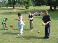 Children playing football in a park