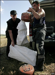The black boxes from the crashed plane are loaded into bags