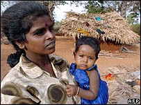 Woman at a resettlement camp near Kilinochchi. 23 August 2006.  (Photo: LAKRUWAN WANNIARACHCHI/AFP/Getty Images)
