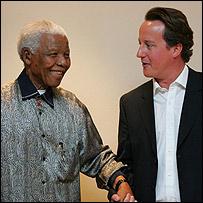 Nelson Mandela (L) and David Cameron