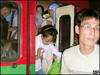 North Koreans migrants being taken to Bangkok detention centre.