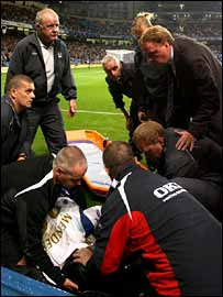 Pedro Mendes receives treatment after being hit by Ben Thatcher