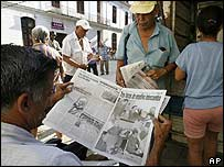 Cubans read about the their ailing leader Fidel Castro in Havana