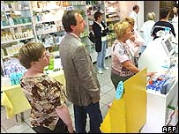German shoppers queuing at a chemist's till