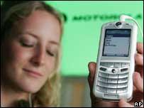 Woman listening to Rokr phone, AP