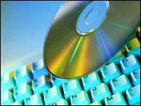 CD next to a keyboard