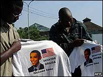 Men holding Obama T-shirts