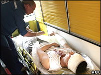 A doctor treats a wounded man in an ambulance at the site of the blast