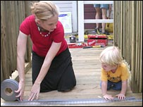 Denice Ross and her son Jamie work on a daycare centre