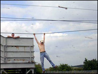 Man dangles from wires