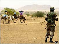African Union peacekeepers watches children on donkeys