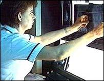 Nurse looking at X-ray