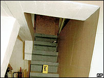 Police photo showing stairs leading to cell