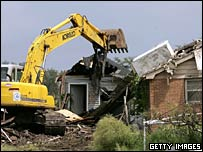 Bulldozer demolishes a house in New Orleans