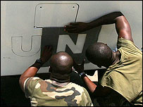 French troops paint UN insignia on their vehicle in Lebanon