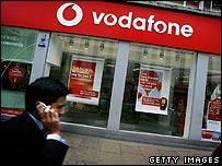 Man outside Vodafone store