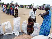 Displaced Ugandans queue for food aid