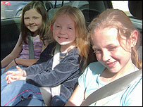 Three children in car seats